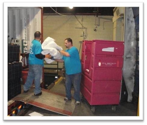 NEOC Movers Load Sheraton Linens for Shipment to El Salvador