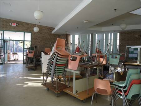 Desks and chairs staged for shipment from the Tahanto Regional School.