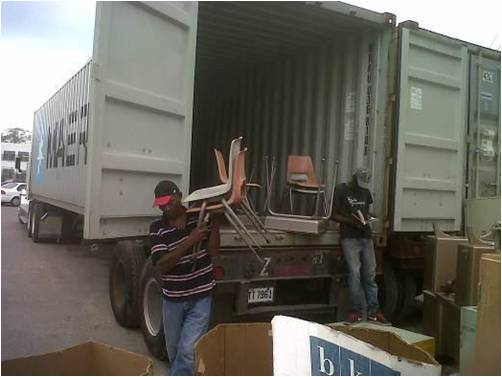 Tahanto desks and chairs being unloaded for reuse, St. Georges School, Kingston, Jamaica