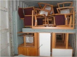 A trailer of Westfield State furniture opened and ready for distribution, Port-au-Prince, Haiti
