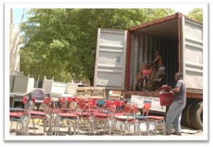 Chairs being unloaded, St. Georges School, Kingston, Jamaica. Does reuse make a difference? You bet it does.