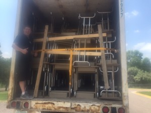 A trailer filled with more than 600 student desks and chairs from Witt Elementary School, packed for shipment to the World Compass Charter School.
